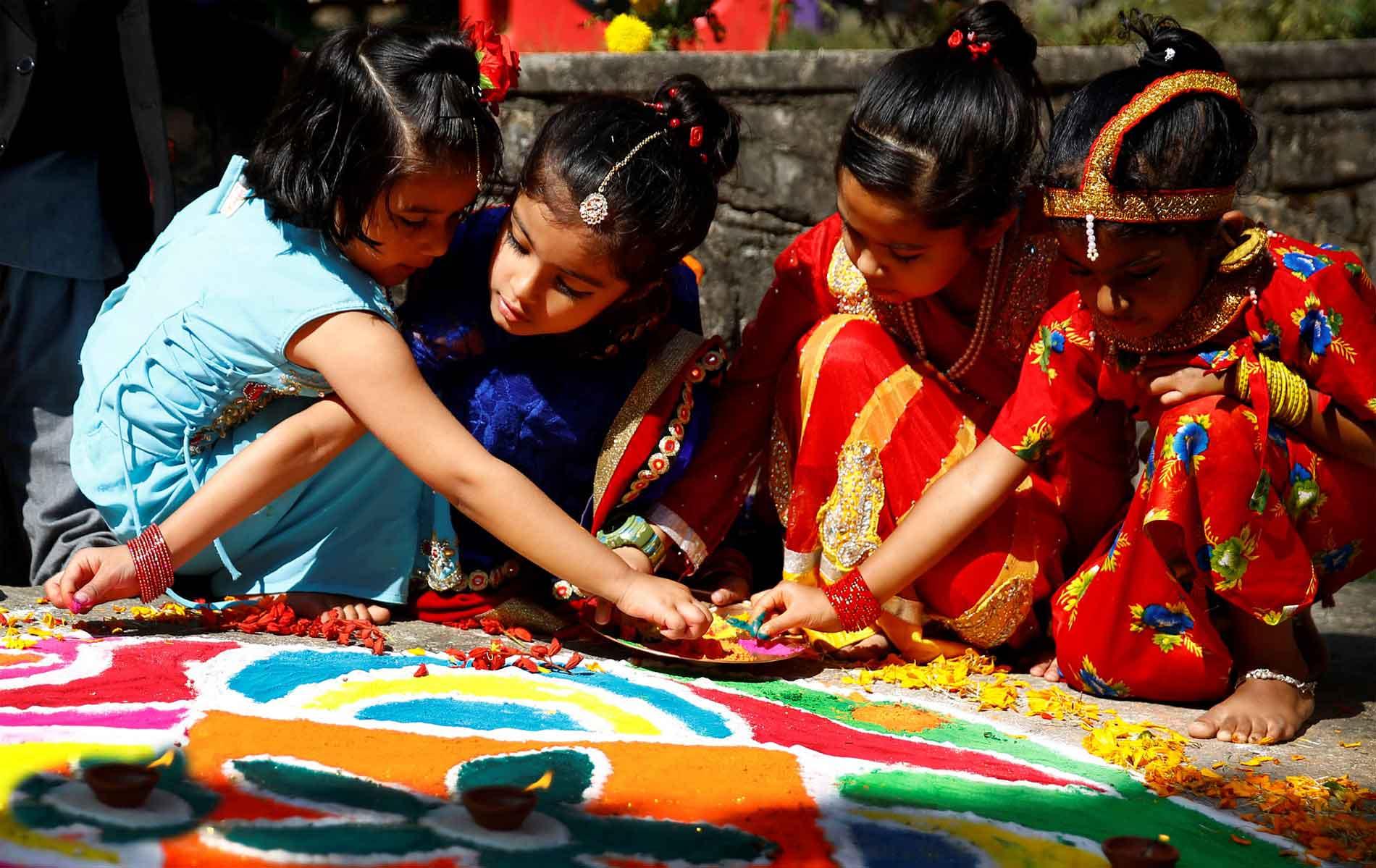 Kids making Rangoli, a customized flower Mandala