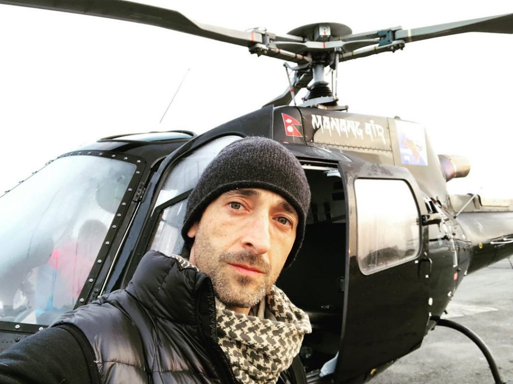 Oscar Winner Andrien Brody visits Nepal for Everest Base Camp Trek and poses in front of Manang Air