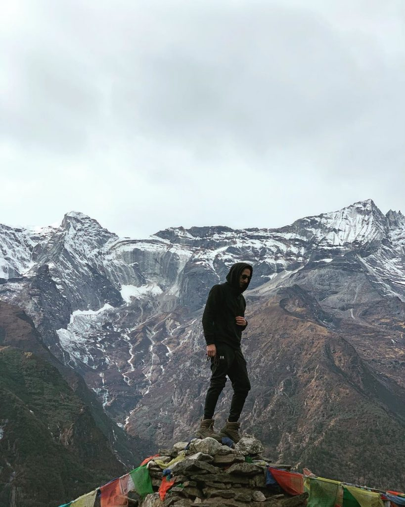 Oscam Winner Andrien Brody visits Nepal for Everest Base Camp Trek and poses on the pile of rocks